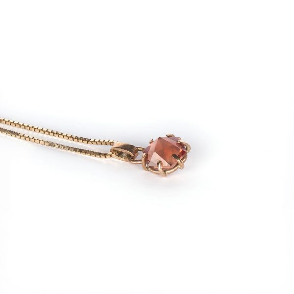 hand cut hexagonal sunstone pendant set in 9ct rose gold side view