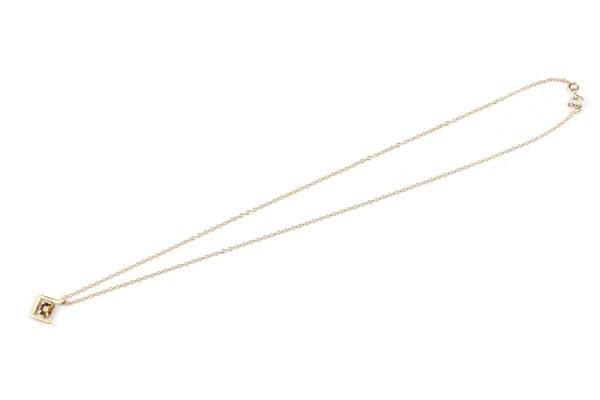 Earth pendant with khaki zircon set in yellow gold flatlay