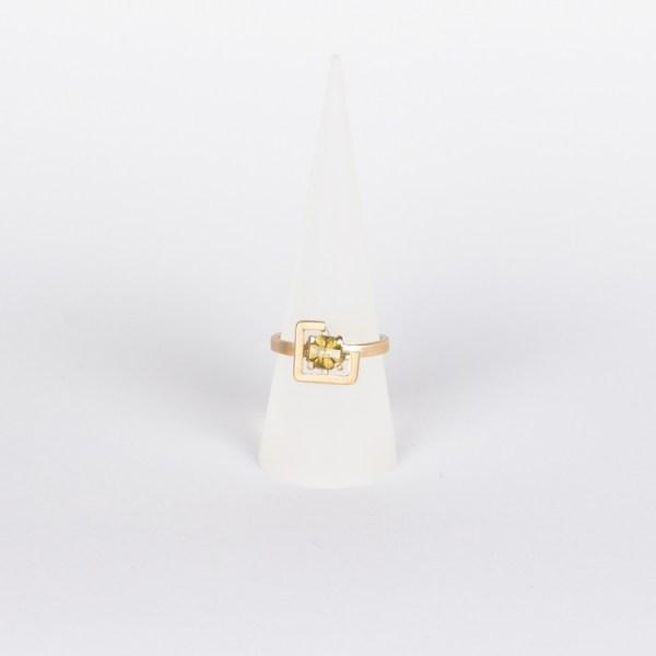 Earth ring greenish yellow zircon set in brushed yellow gold cone