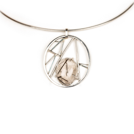Tourmalinated quartz set in geometric sterling silver