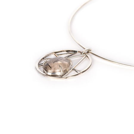 Tourmalinated quartz set in geometric sterling silver side view left