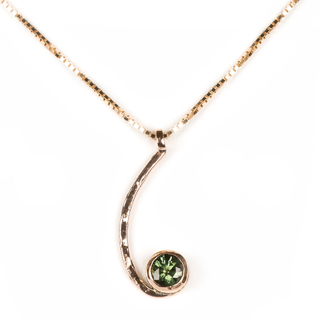 Green sapphire pendant set in rose gold front view
