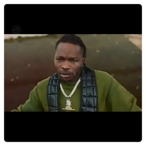 Naira Marley in green top in video of As E Dey Go