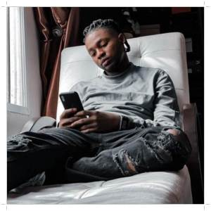 Nigerian Music act, Omah Lay reading book