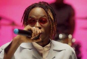 Love & Romantic songs star, Fireboy DML holding mic