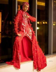 Denrele Edun on red dress at his birthday party