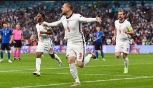 Luke Shaw celebrating opening goal along with Kane & Sterling against Italy at EURO 2020 Final