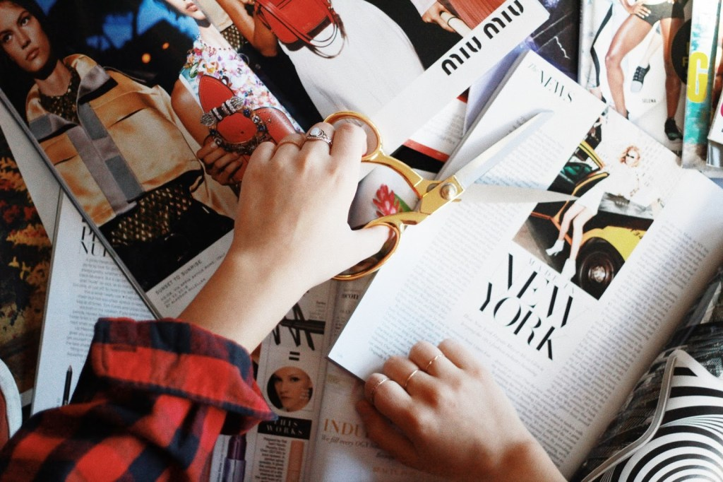 cutting out clips from magazines