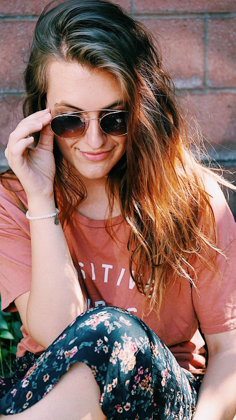 round 70s sunglasses beach hair