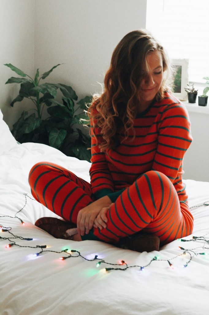 women striped christmas pajamas at home
