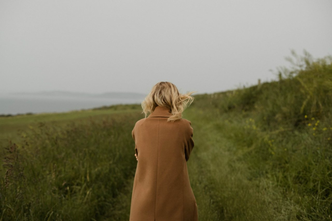 Dealing with Depression Without Medication girl walking through field