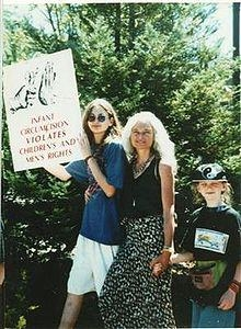 Jeannine Parvati and two youngest children protesting circumcision.