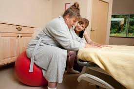 Canadian midwife with client