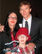 Rebecca and Abigael Blasco with David Woodruff