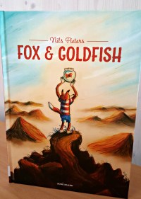 Fox holding a goldfish bowl