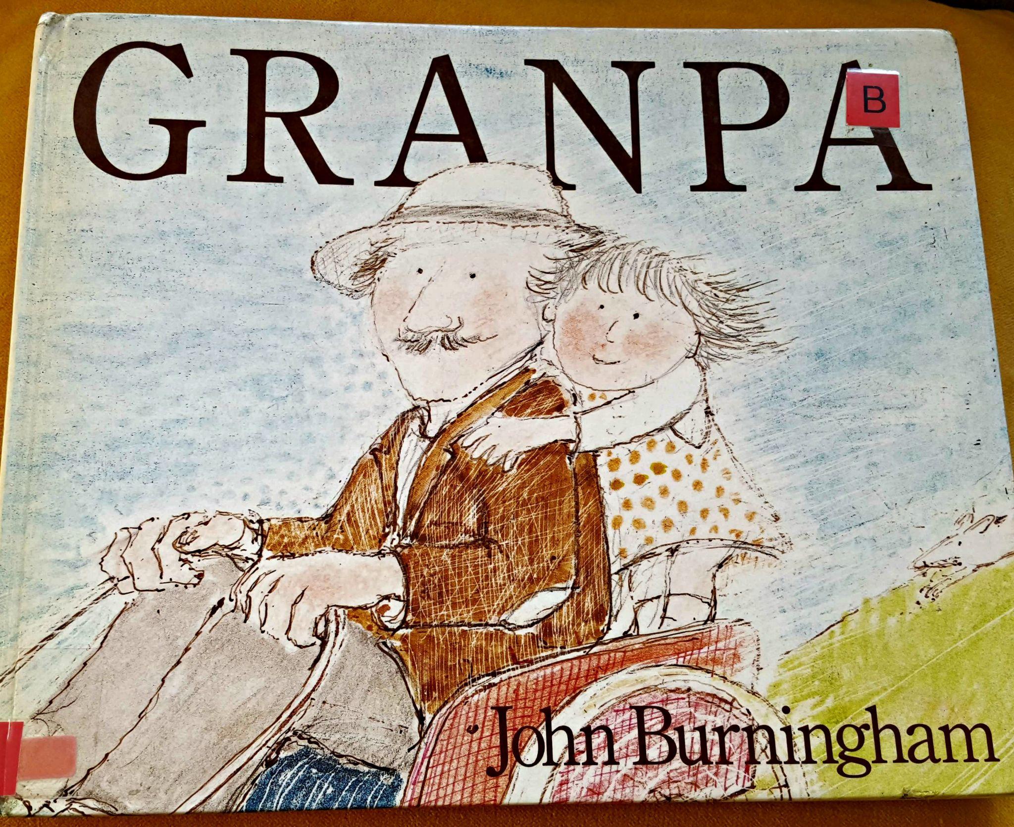 Little girl on Granpa's wheelchair
