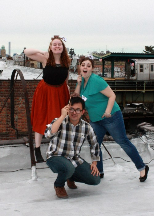 Claire and Erin pose with Ben Abraham for Wishbonafide Episode 2 on a city rooftop