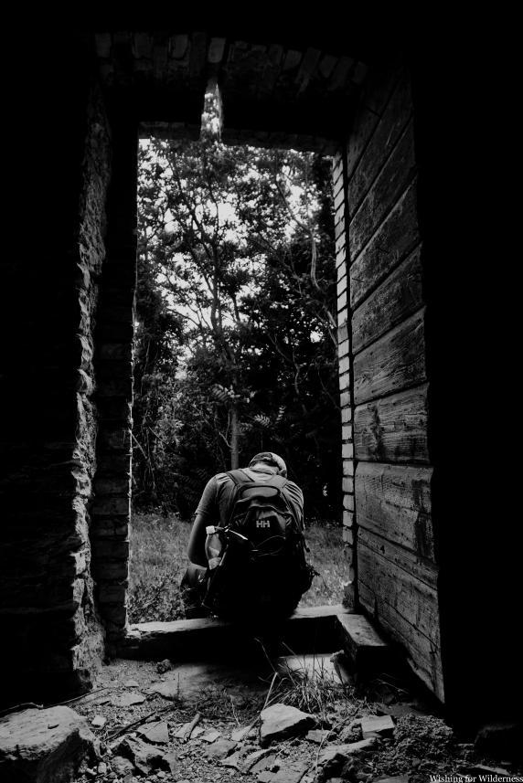 Black and white photo in derelict doorway
