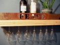 Shelf with cutout and hanging wine glasses