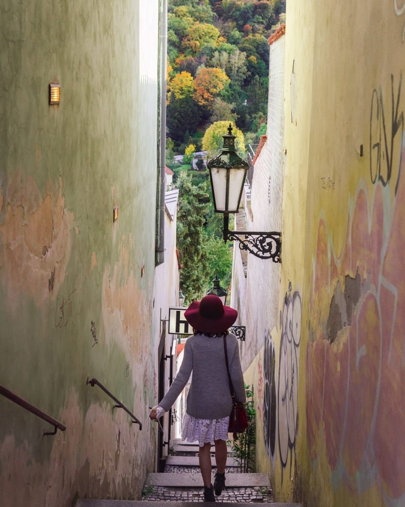 picture of girl in the narrowest street in Prague
