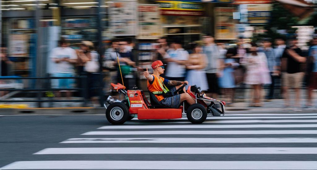 person racing a mari car in japan