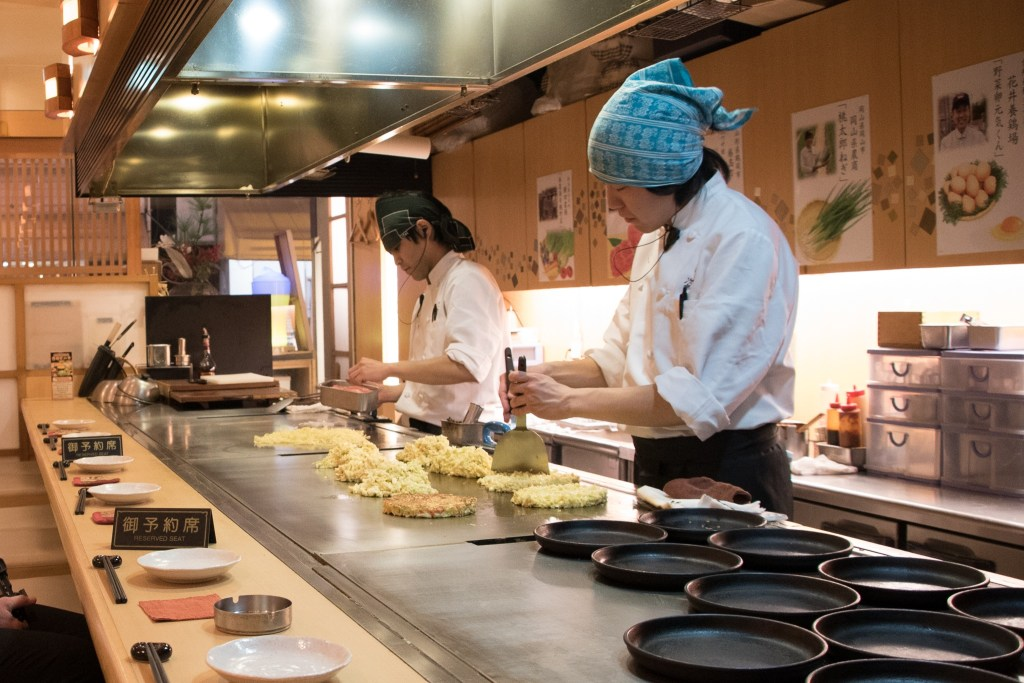 chefs cooking okonomiyaki