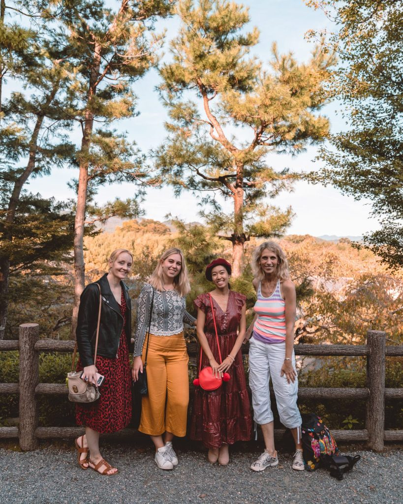 women smiling in Kyoto temple