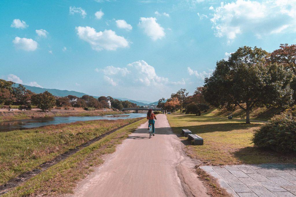 girl riding bike on empty road