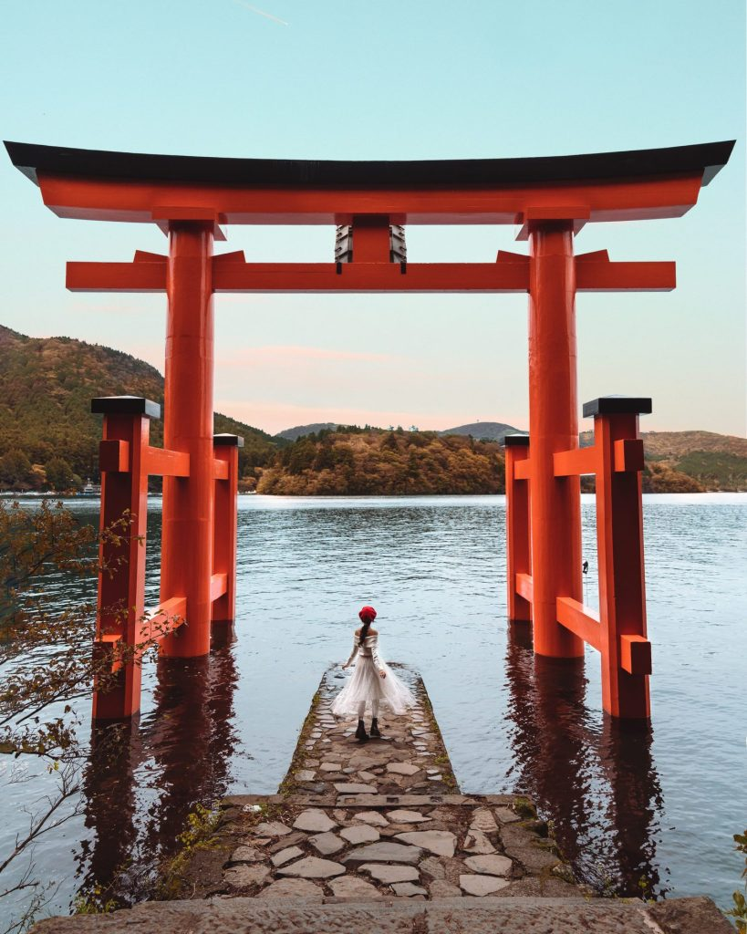 girl in front of Hakone red torii gate shrine