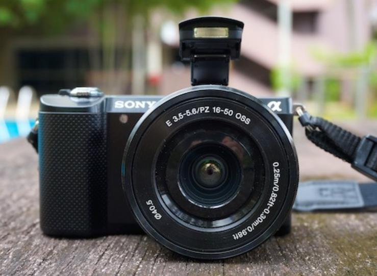 photo of a black camera on a table