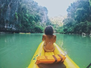 Image shot from behind in yellow kayak during Phang Nga Bay tour in Thailand