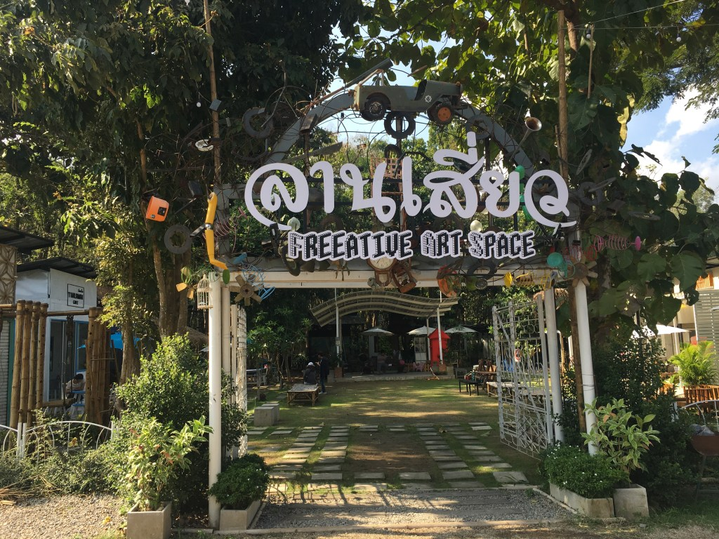 Sign for and entrance to Freeative Art Space on the walk to Baan Kang Wat in Chiang Mai, Thailand