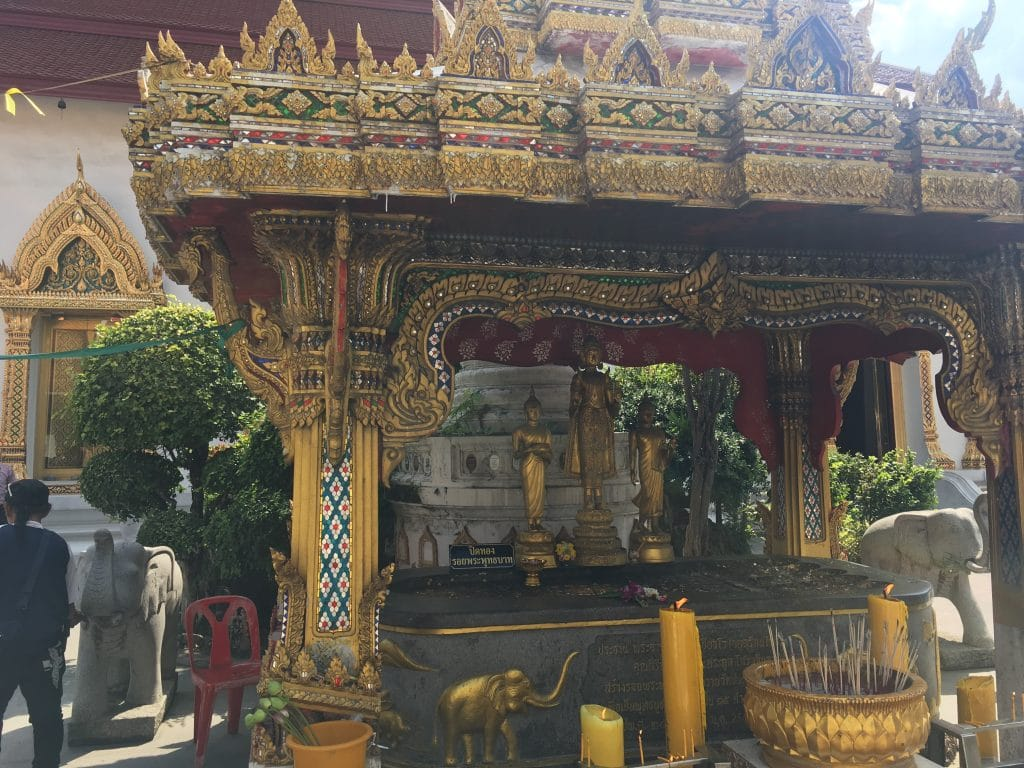 Offering ceremony area at Wat Chana Songkram, where we lit incense, burned candles, and dipped lotus flowers in water.