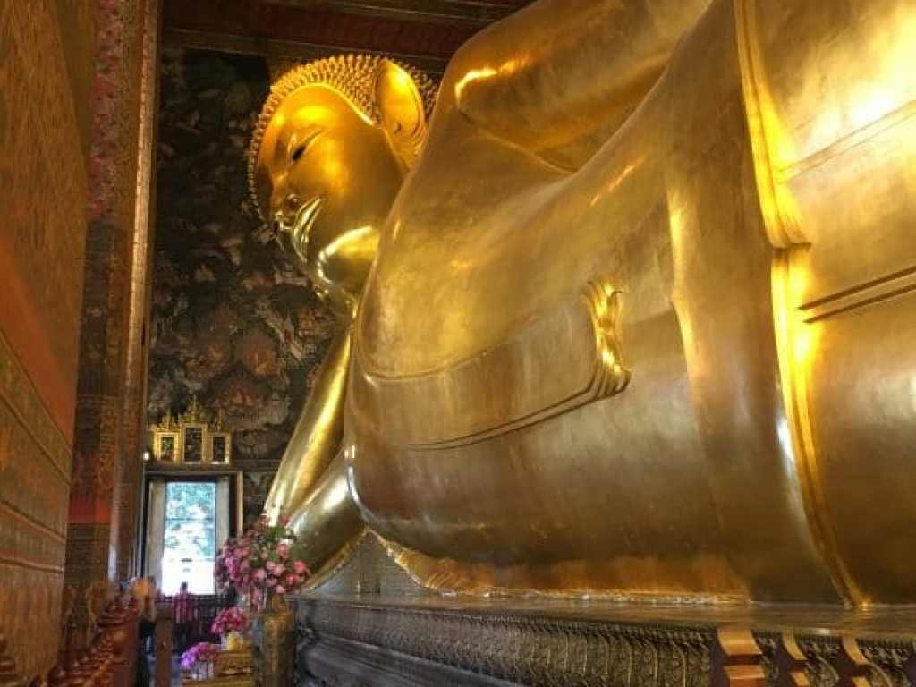 Reclining Buddha statue inside temple. The statue is so big, the photos had to be taken in two different frames!