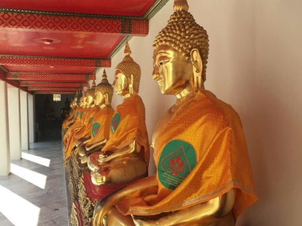 Beautiful gold Buddha statues at the Temple of the Reclining Buddha