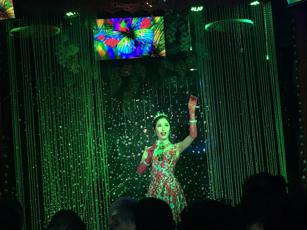Photo of performer in sparkling dress and crown at Ram Bar cabaret in Chiang Mai, Thailand