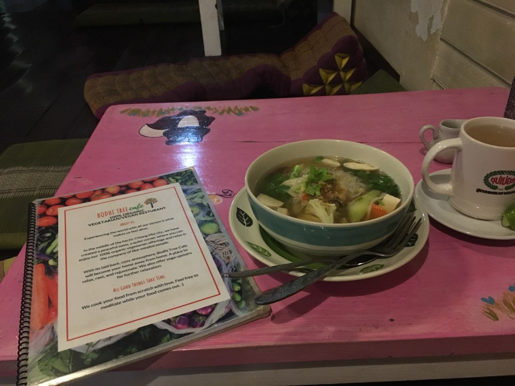 Hearty noodle soup with vegetables at Bodhi Tree Cafe as last meal in Chiang Mai, Thailand