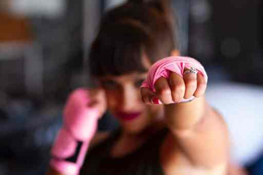 Photo of woman punching with wedding ring by Sarah Cervantes