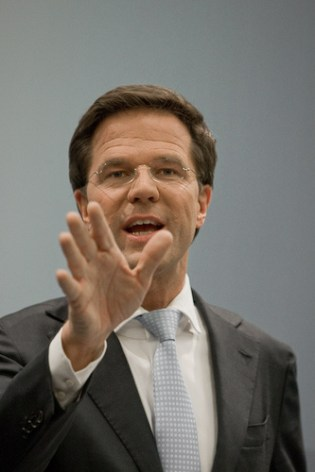 mark rutte looking at his hand