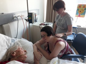 Talking to Oma while she was still conscious, with my sister Kathryn standing behind.