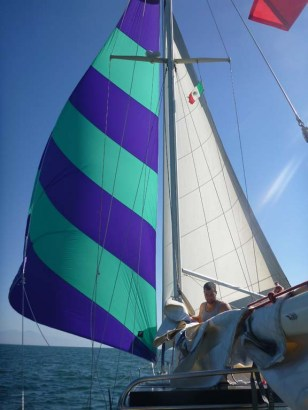 Nor'West 33 Brio under spinnaker and Genoa