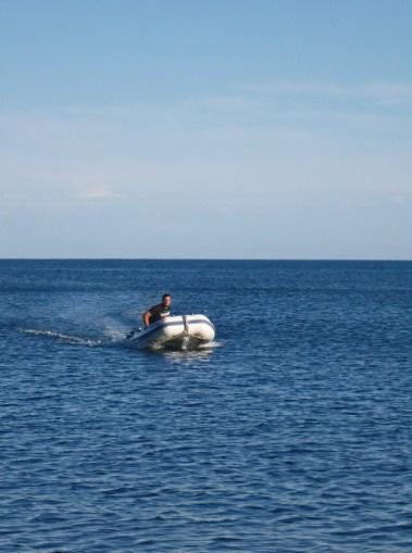 Jon in the dinghy