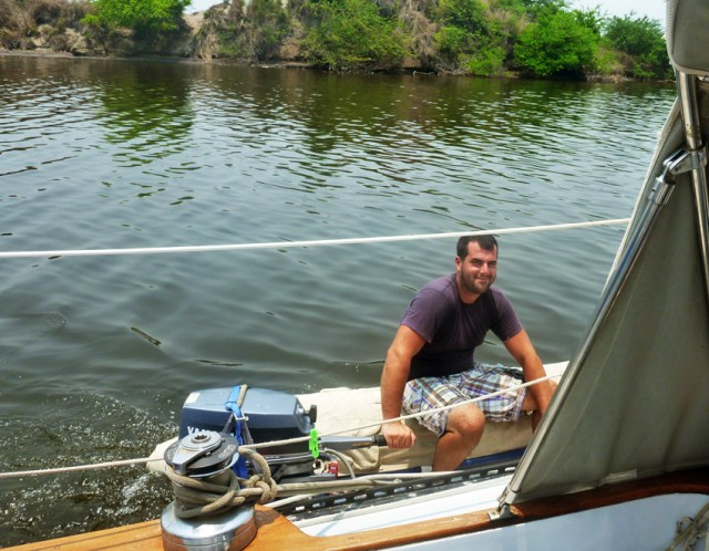 Pushing the boat in to Chiapas with the dinghy -- God bless Yamaha 15hp outboards!