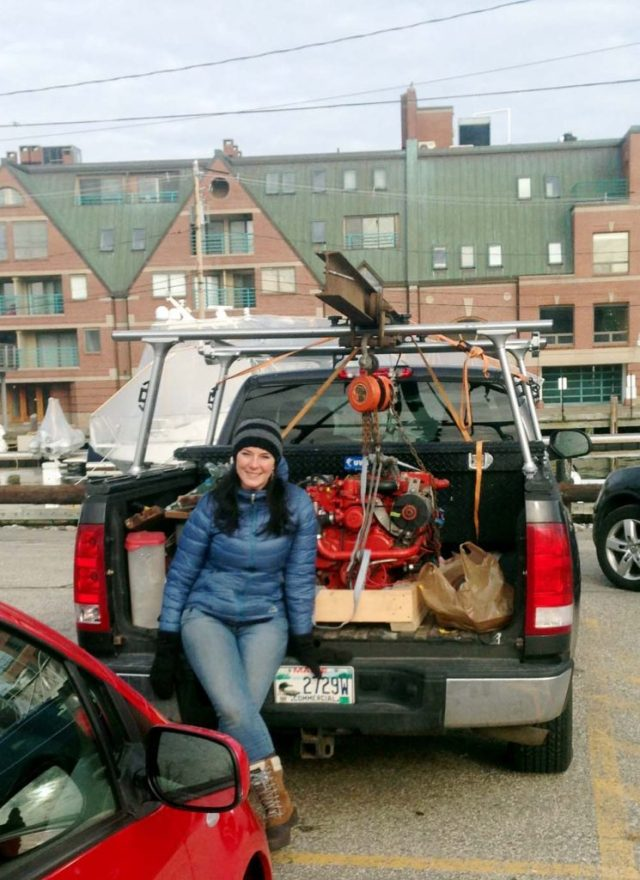 Repowering a sailboat engine - loading the Westerbeke 21 into the truck bed with a giant beam