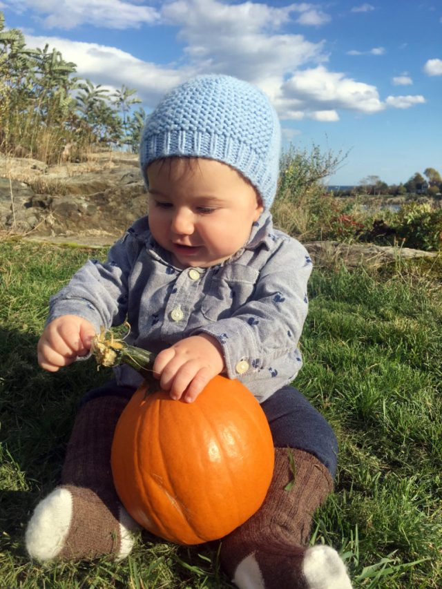 Six months old with a pumpkin - Fall in Maine