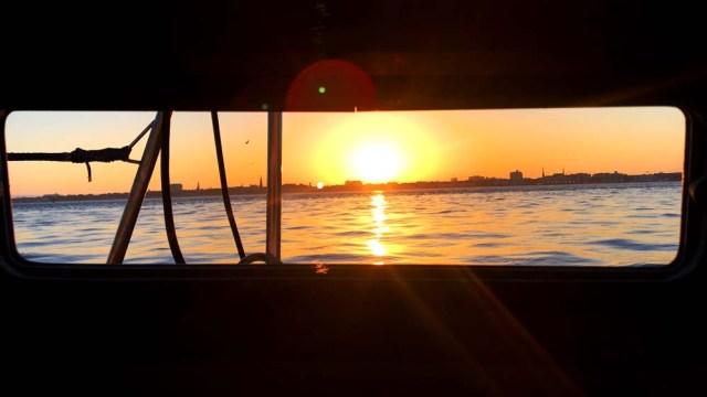 Charleston sunset through the porthold from Charleston Harbor Marina