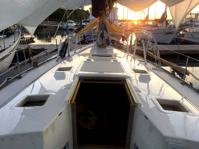 Painting the cabintop of a Sabre 42 CB sailboat with hatches removed in Alexseal