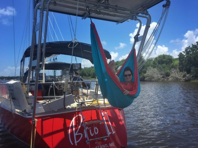 Making the most of the ENO hammock off the radar arch - living the best life on our Sabre 42 sailboat!
