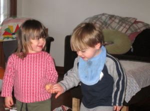 Max - your mother should change that bib... but she just did!  I love when they love each other....