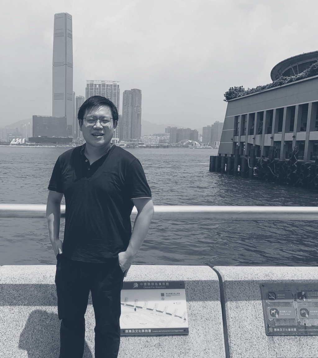William Wong standing by Hong Kong harbour.